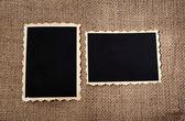 Fotos antiguas en blanco sobre fondo de tela de saco — Foto de Stock