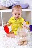 Cute little boy with wooden toy blocks in room — Foto Stock