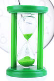 Hourglass on big clock  background — Zdjęcie stockowe