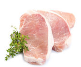 Raw meat steak with herbs isolated on white — Stock fotografie