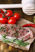 Raw meat steak with spices  herbs, on wooden background — Stock Photo