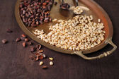 Cedar pine nuts on old metal tray, on wooden table — Stock Photo