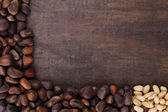 Cedar pine nuts on wooden background — Stock Photo