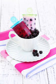 Fruit ice cream in cup on wooden table close-up — Stock Photo