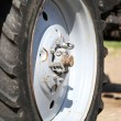 Big tractor wheel, close-up — Stock Photo #46456433