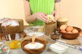 Woman preparing Easter cake in kitchen — Stok fotoğraf