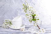Beautiful fruit blossom in glass on table on grey background — Stock fotografie