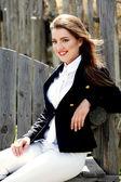 Woman in horseback riding costume — Stock Photo