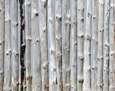Wooden fence on sky background — Stock Photo
