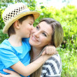 Happy mom and son in the park — Stock Photo #46462409