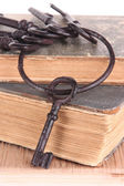 Old key and old books — Stock Photo