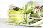 Green table settings, on table, on light background — Stock Photo
