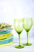 Color table settings, on table, on light background — Stock Photo