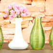Different decorative vases on shelf on brick wall background — Stock Photo