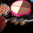 Professional make-up tools on black background — Stock Photo