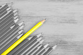 Concept of individuality.One bright color pencil among grey pencils — Stockfoto