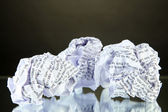 Crumpled paper balls on table on gray background — Stock Photo