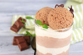 Tasty chocolate mousse with sorbet on wooden table — Stock fotografie