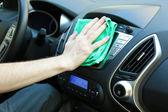 Hand with microfiber cloth polishing car — Stock Photo