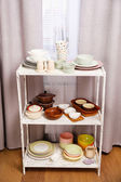 Different tableware on shelf in the interior — Stockfoto
