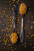 Spice  pollen in spoons on wooden background — Stock Photo
