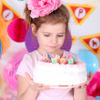 Pretty little girl with cake celebrate her birthday — Stock Photo #46530135