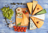 Different Italian cheese on wooden table — Stok fotoğraf