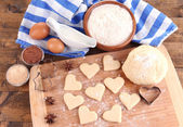 Making cookies on wooden background — Stock Photo