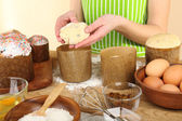 Woman preparing Easter cake — Stock Photo