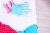 Unmade bed close up — Stock Photo