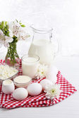 Tasty dairy products on wooden table — Stock Photo