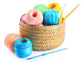 Colorful yarn for knitting with napkin in wicker basket and crochet hook, isolated on white — Stock Photo
