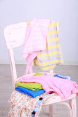 Clothes on chair on gray background — Stock Photo