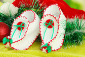 Christmas shoes with decorations on fabric background — Stock Photo