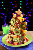 Fruit Christmas tree on table on dark background — Foto de Stock