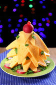Christmas tree from cheese on table on dark background — Stockfoto