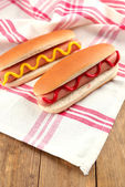 Tasty hot dogs on wooden table — Foto de Stock
