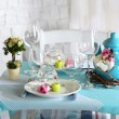 Beautiful holiday Easter table setting in blue tones, on light background — Stock Photo
