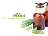 Fresh green aloe leaves and medicine bottles, isolated on white — Stock Photo