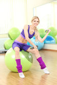 Young woman training with gymnastic ball in gym — Foto de Stock
