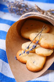 Lavender cookies in paper bag, on color napkin background — Foto de Stock