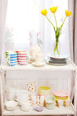 Different tableware on shelf in the interior — Foto de Stock