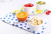 Various sliced fruits in bowls on table close-up — Foto de Stock