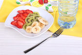 Various sliced fruits on plate on table close-up — Foto de Stock