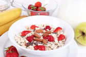 Healthy cereal with milk and fruits close up — Foto de Stock
