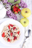 Healthy cereal with milk and fruits on wooden table — Stock Photo