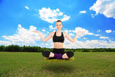 Beautiful girl fly and meditating in yoga pose — Stock Photo