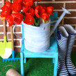 Composition of colorful tulips in watering can and rain boots on bright background — Stock Photo #46603965