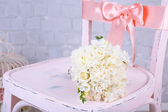 Beautiful wedding bouquet on wooden chair — Stock Photo