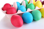 Colorful Easter eggs in tray isolated on white — Stock Photo